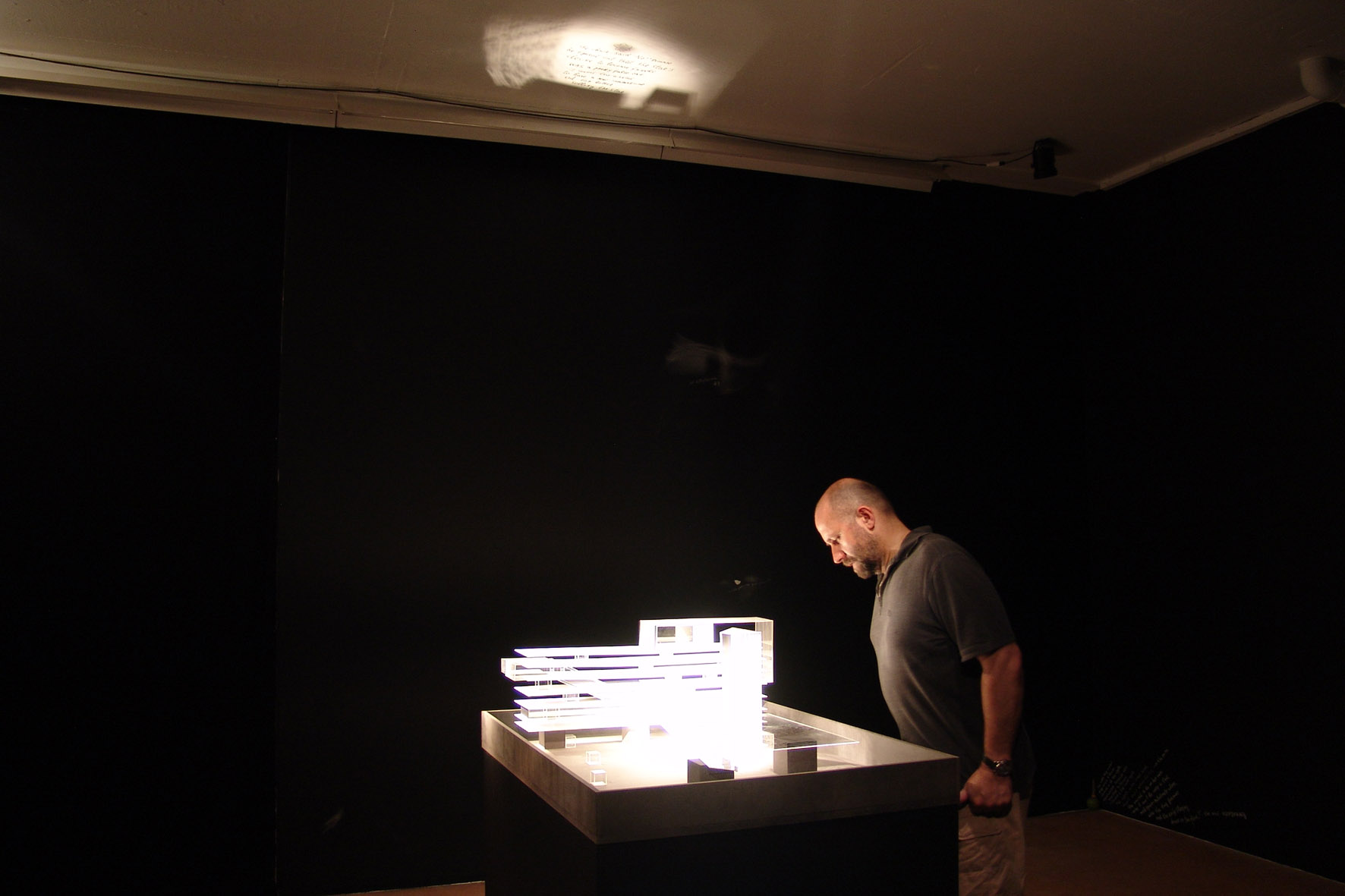 Nedko Solakov in front of his model of the virtual Mixm